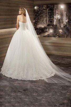 Robe de mariée delicat romantique textile en tulle avec lacets decoration en fleur